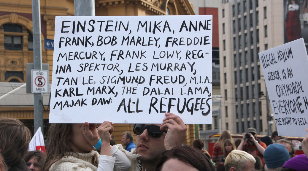 Sign listing some notable refugees